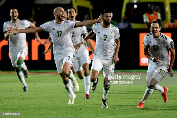 Algeria's players celebrate their winning goal during the 2019 Africa Cup of Nations Semifinal football match between Algeria and Nigeria at the...