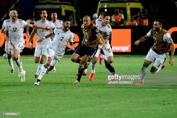 TOPSHOT Algeria's players celebrate their winning goal during the 2019 Africa Cup of Nations Semifinal football match between Algeria and Nigeria at...