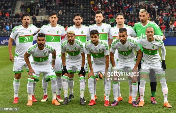 Algeria's players forward Hillel Soudani midfielder Riyad Mahrez defender Farouk Chafai midfielder Salim Boukhenchouche midfielder Sofiane Hanni and...