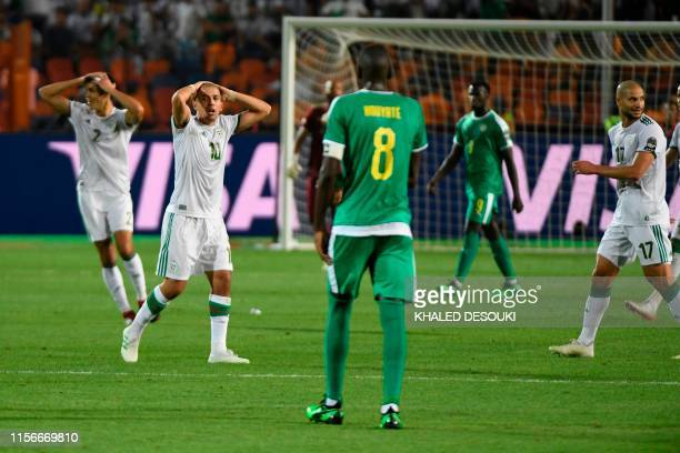 Algeria's players react during the 2019 Africa Cup of Nations Final football match between Senegal and Algeria at the Cairo International Stadium in...