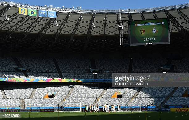 Algeria's players run during a training session at the Mineirao Stadium in Belo Horizonte on June 16 on the eve of Belgium's 2014 FIFA World Cup...