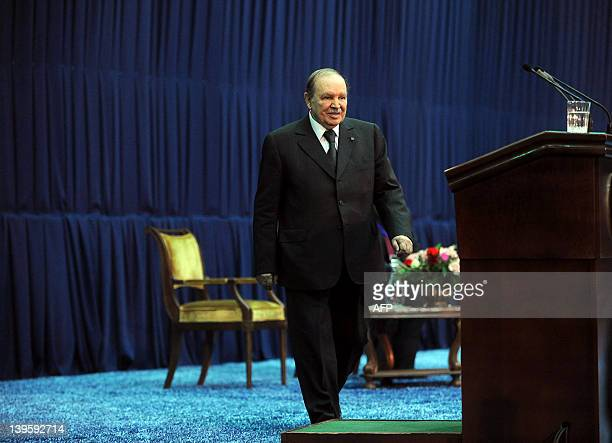 Algeria's President Abdelaziz Bouteflika walks to the podium to deliver a speech on the occasion of the 41st anniversary of hydrocarbons...