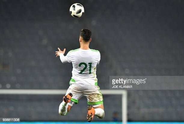 TOPSHOT Algeria's Ramy Bensebaini heads a ball during the international friendly football match between Iran and Algeria at the Merkur Arena in Graz...