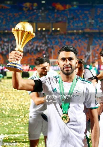 Algeria's Riyad Mahrez celebrates with the trophy during the award ceremony after Algeria defeated Senegal in the 2019 Africa Cup of Nations final...