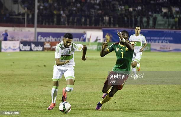 Algeria's Ryad Mahrez vies with Cameroon's Toko Ikambi Kar during the FIFA World Cup 2018 qualifying football match between Algeria and Cameroun on...