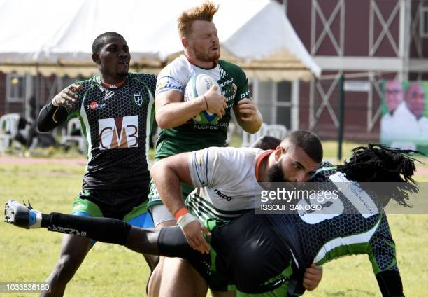 Algeria's Sebastien Abdelkader vies for the ball with Nigerian players during the Africa Rugby Sevens Championship in Abidjan on September 15 2018