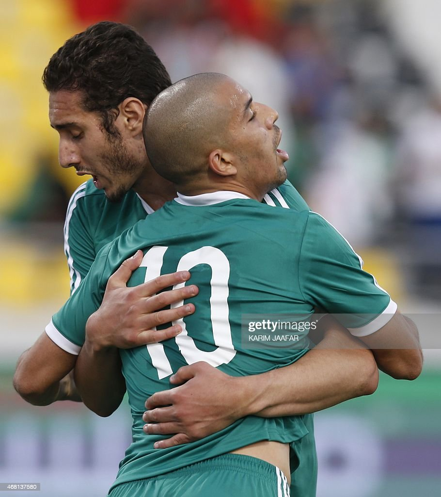Algeria's Sofiane Feghouli (front) celebrates with his teammate Ishak Belfodil after scoring a goal during their friendly football match against Oman on March 30, 2015 at the Qatar Club Stadium in Doha, as part of the preparations for the second round of the 2018 World Cup's Asian leg qualifiers.