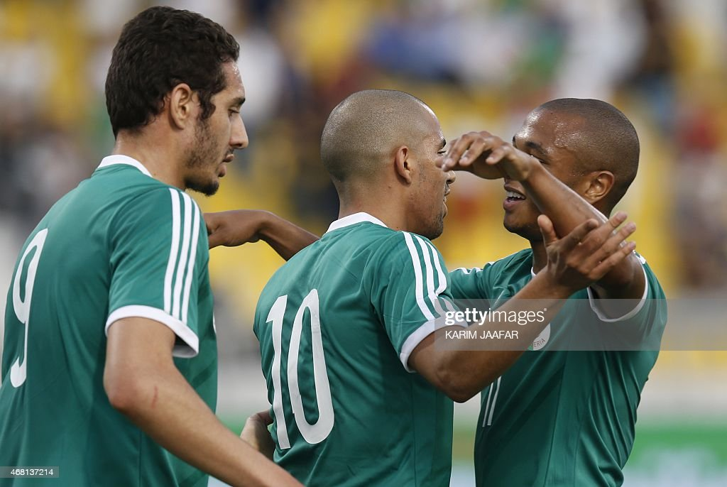 Algeria's Sofiane Feghouli (C) celebrates with his teammates after scoring a goal during their friendly football match against Oman on March 30, 2015 at the Qatar Club Stadium in Doha, as part of the preparations for the second round of the 2018 World Cup's Asian leg qualifiers.