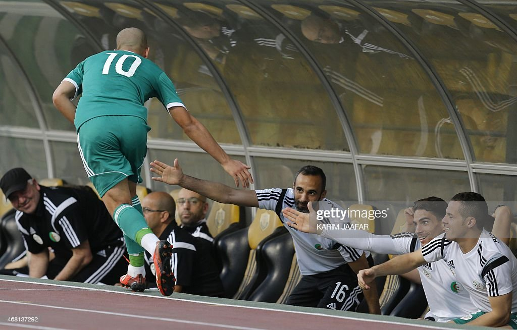 Algeria's Sofiane Feghouli (L) celebrates with his teammates after scoring a goal during their friendly football match against Oman on March 30, 2015 at the Qatar Club Stadium in Doha, as part of the preparations for the second round of the 2018 World Cup's Asian leg qualifiers.
