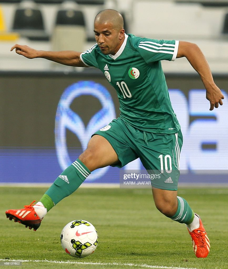 Algeria's Sofiane Feghouli dribbles the ball during their friendly football match against Oman on March 30, 2015 at the Qatar Club Stadium in Doha, as part of the preparations for the second round of the 2018 World Cup's Asian leg qualifiers.
