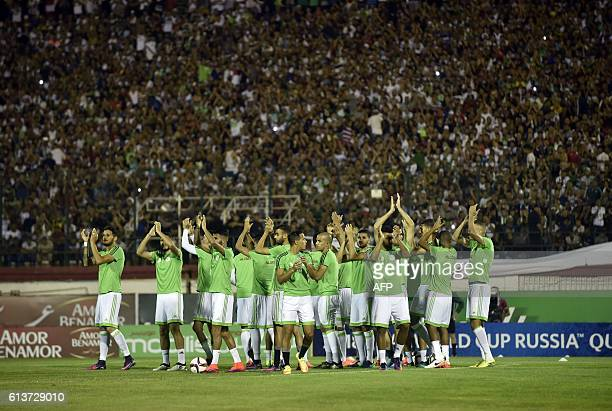 Algeria's team clap to their fans prior to the FIFA World Cup 2018 qualifying football match between Algeria and Cameroon on October 9 2016 at Stade...