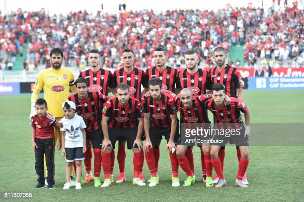CORRECTION Algeria's USMA players pose for a group picture prior to the CAF Champions League group stage football match between USM Alger and Caps...