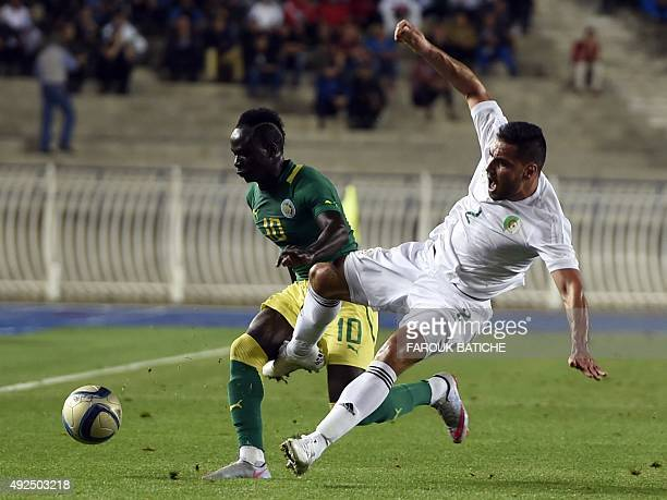 Algeria's Ziti Mohamed vies with Senegal's Mane Sadio during a friendly football match on October 13 2015 in Algiers as part of the teams preparation...