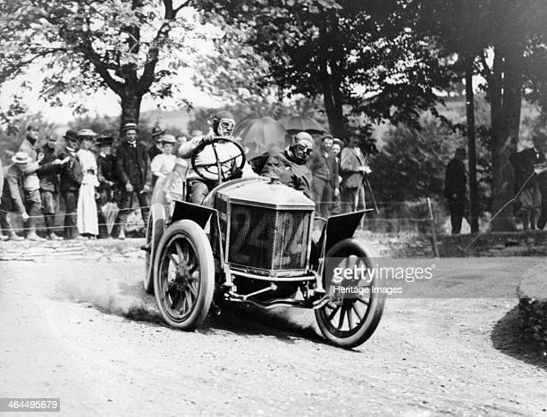 Algernon Guinness driving a Minerva in the Circuit des Ardennes 1907 As the driver takes the bend a cloud of dust rises from the back wheels The...