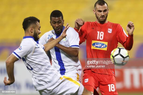 AlGharafa's Abdulaziz Hatem vies for the ball against Tractor Sazi's Sulejman Krpic during the AFC Champions League Group A football match between...