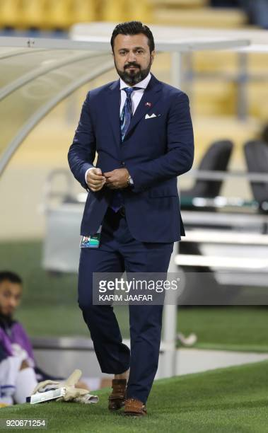 AlGharafa's coach Bulent Uygun watches from the sidelines during the AFC Champions League Group A football match between Qatar's AlGharafa and...
