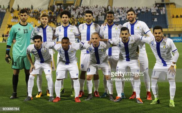 AlGharafa's first eleven pose for a team photo prior to the start of the AFC Champions League Group A football match between Qatar's AlGharafa and...