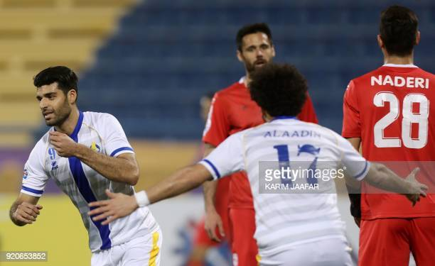 AlGharafa's Mehdi Taremi celebrates with his teammates after scoring a goal during the AFC Champions League Group A football match between Qatar's...