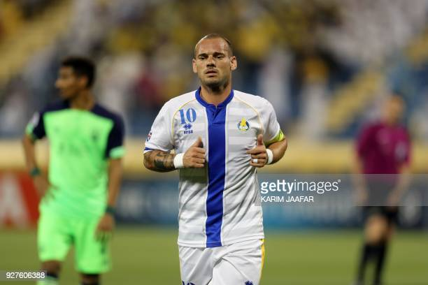AlGharafa's midfielder Wesley Sneijder runs on the pitch during the AFC Champions League football match between alGharafa and AlAhli at the Thani Bin...