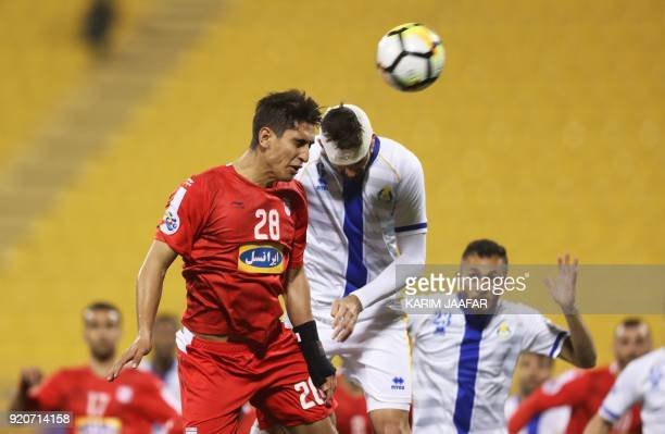 AlGharafa's Rubert Jose Quijada Fasciana jumps to head the ball against Tractor Sazi's Mohammad Naderi during the AFC Champions League Group A...