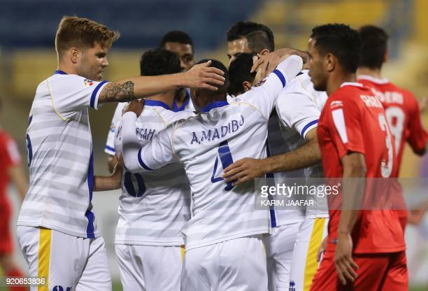 AlGharafa's team players celebrate after scoring a goal during the AFC Champions League Group A football match between Qatar's AlGharafa and Tractor...
