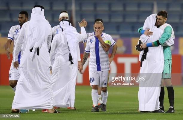 AlGharafa's Wesley Sneijder celebrates with the team after winning the AFC Champions League Group A football match between Qatar's AlGharafa and...
