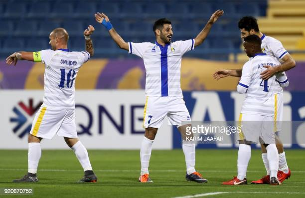 AlGharafa's Wesley Sneijder Fuhaid Sattam and Assim Madibo celebrate after scoring goal during the AFC Champions League Group A football match...