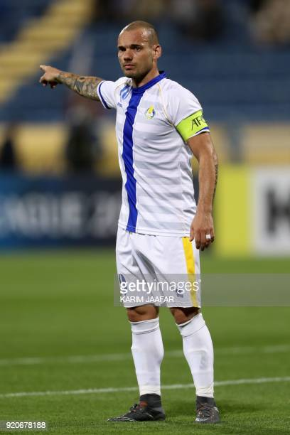 AlGharafa's Wesley Sneijder reacts on the pitch during the AFC Champions League Group A football match between Qatar's AlGharafa and Tractor Sazi...