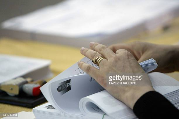 A scrutineer counts ballot papers prior to polls opening for the parliamentary elections in Algiers City 17 May 2007 Polls opened today to elect a...