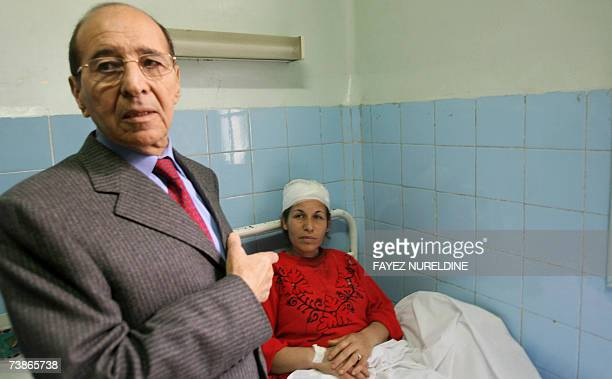 Algerian Interior Minister Noureddine Zerhouni gestures as he comforts a injured woman during his visit in Mostapha Bacha hospital in Algiers City 12...