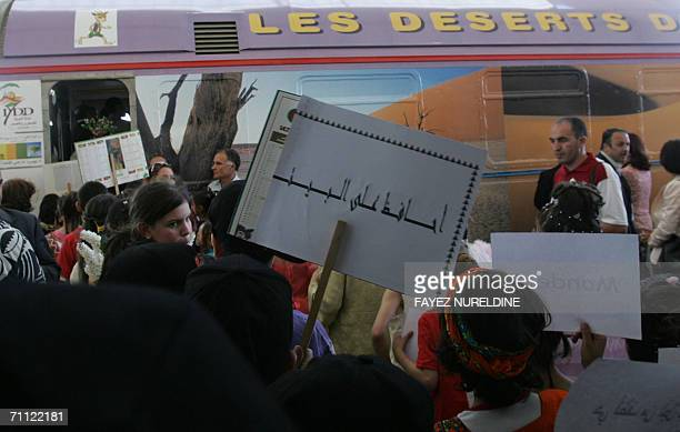 Children hold posters near the socalled 'Environment Train' decorated for World Environment Day in Algiers 04 June 2006 The United Nations designated...