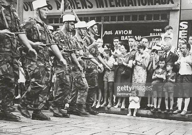 Little Girl And The Legion A tiny French girl pleased by the sight of Foreign Legion paratroopers marching by during the Bastille Day Parade in...