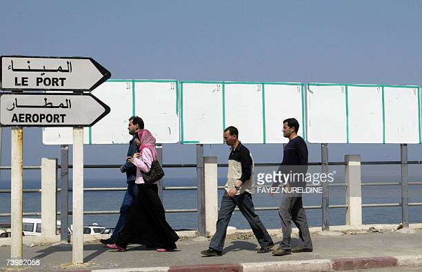 Local residents walk past empty electoral billborads in Algiers City 26 April 2007 The official campaign for Parliamentary elections in Algeria...
