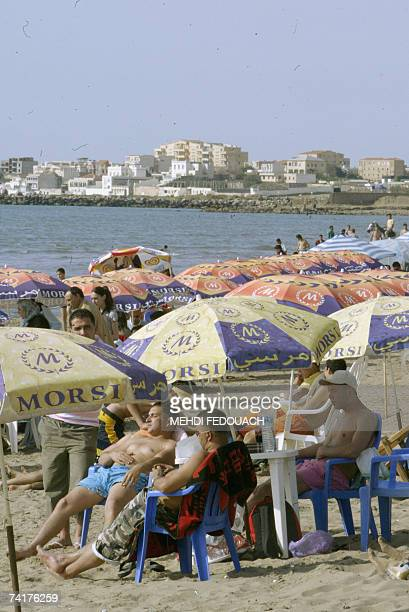 Local sunbathers take a break on PalmBeach a district on the waterfront of Algiers City 17 may 2007 As Algeria went to the polls on Thursday to elect...
