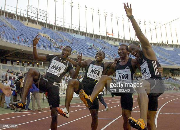 Nigeria's Isaac Uche Metu Obina Chinedu Oriala and Fasuba Olusoji celebrate holding their national flag after they won the gold medal 20 July 2007 in...