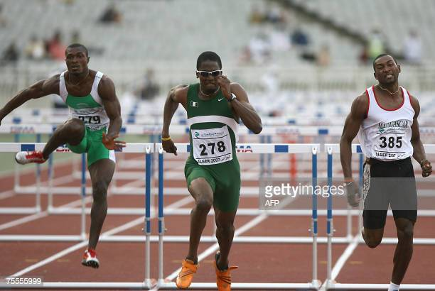 Nigeria's Nurudeen Salim races to win followed by his teammate Okon Samuel and Madagascar's Randriamihaja Berlioz 19 July 2007 in the Men's 110m...