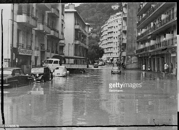 Storm And Flood Ravage StrifeTorn Algeria At left above is a view of one of the main streets in Algiers after rainstorms and violent winds caused...