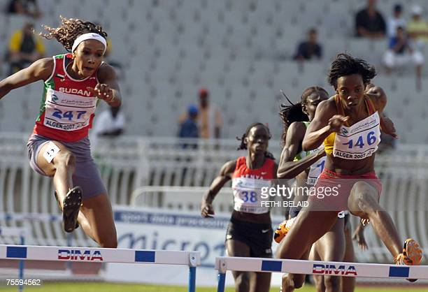 Sudan's Nuna Jabir races to win the gold medal followed by Burkina Faso's Soulama Aissata 22 July 2007 in the women's 400 M Hurdles final at the 9th...
