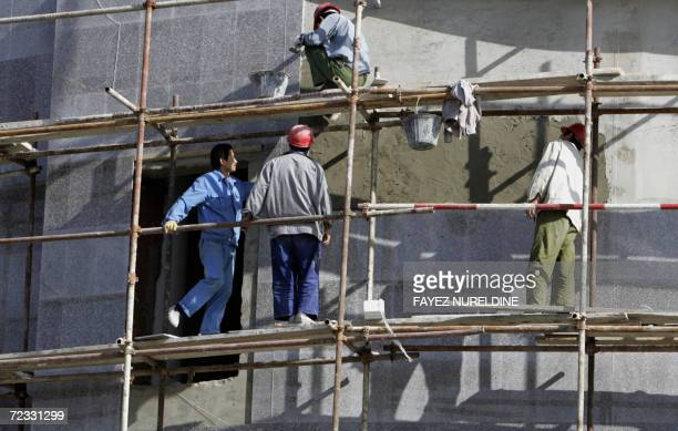 TO GO WITH AFP STORY A picture taken 31 October 2006 shows Chinese men working on the AlQuds commercial center in Algiers City Al Quds center is...