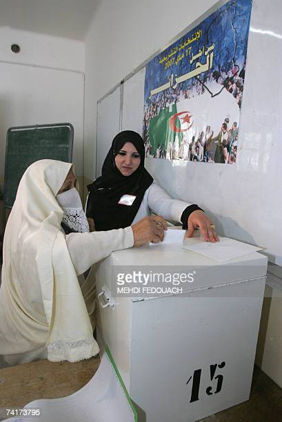 Women cast their ballots at a polling station in Algiers City 17 may 2007 In Algeria's only third multiparty parliamentary election there is concern...