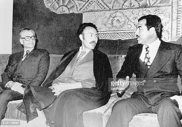 Algeria's President Houri Boumedienne is flanked by Shah Mohammed Reza Pahlevi of Iran and Iraq's Saddam Hussein vice president of Iraq's Council of...