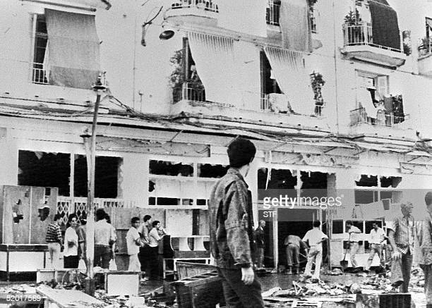 Algiers citizens help to clean up the main avenue of the Belcourt area in Algiers 08 October 1988 after three days of rioting