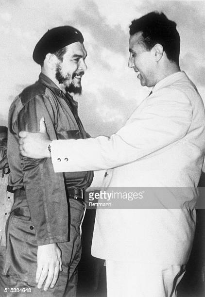 Cuba's Ernesto 'Che' Guevera gets hearty greeting from Algerian Premier Ahmed Ben Bella as he arrives here July 4th Major Guevera heads Cuban...