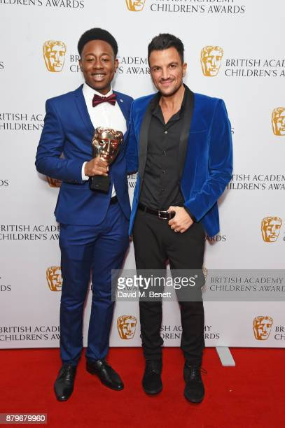 Alhaji Fofana winner of the Performer award and presenter Peter Andre pose in the winners room at the BAFTA Children's Awards at The Roundhouse on...