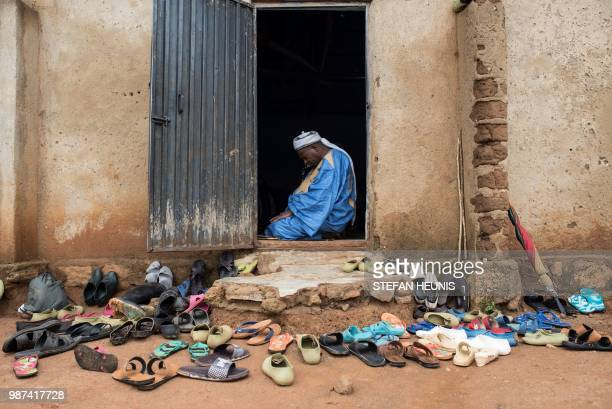 Alhaji Shaibu Bayeru chairman of the MiyettiAllah Cattle Breeders Association of Nigeria prays in the mosque of the Fulani village of Luggere in the...