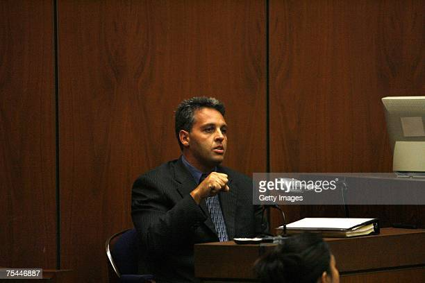 Alhambra Police Officer James Hammond testifies in the murder trial of music producer Phil Spector in Superior Court July 17, 2007 in Los Angeles,...