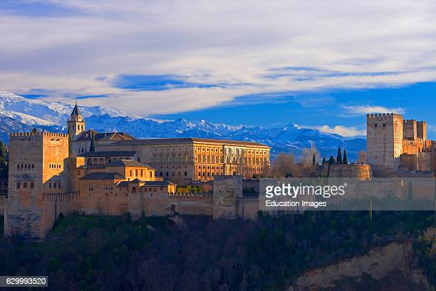 Alhambra UNESCO World Heritage Site Sierra Nevada and la Alhambra at Sunset Granada Andalusia Spain