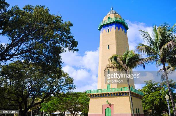 alhambra water tower in coral gables, fl with palm trees - coral gables stock pictures, royalty-free photos & images