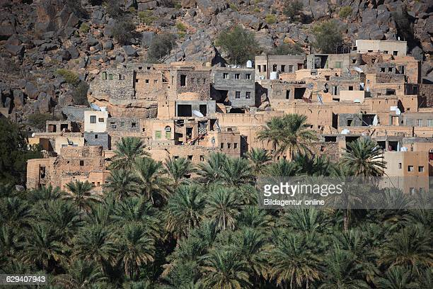AlHamra is one of many interesting oases with an old mucky part with red houses on stone foundations Here the district of Misfah with the precipitous...