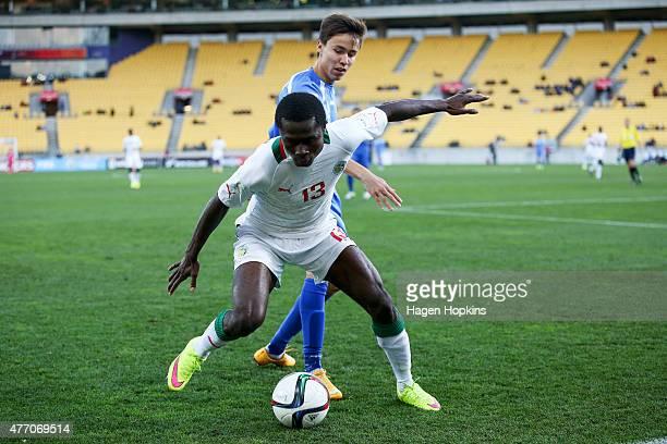 Alhassane Sylla of Senegal holds off Khurshid Giyosovof Uzbekistan during the FIFA U20 World Cup New Zealand 2015 quarterfinal match between Senegal...